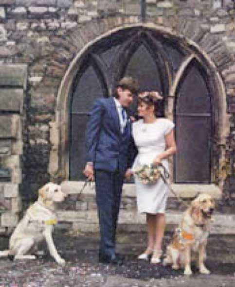 Steve, Geraldine on their wedding day with their guide dogs